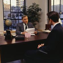 Businessmanatmeetinginoffice..JPG