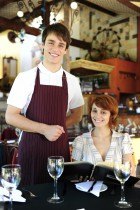Waiter and client at restaurant