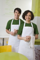 Smiling servers at cafe